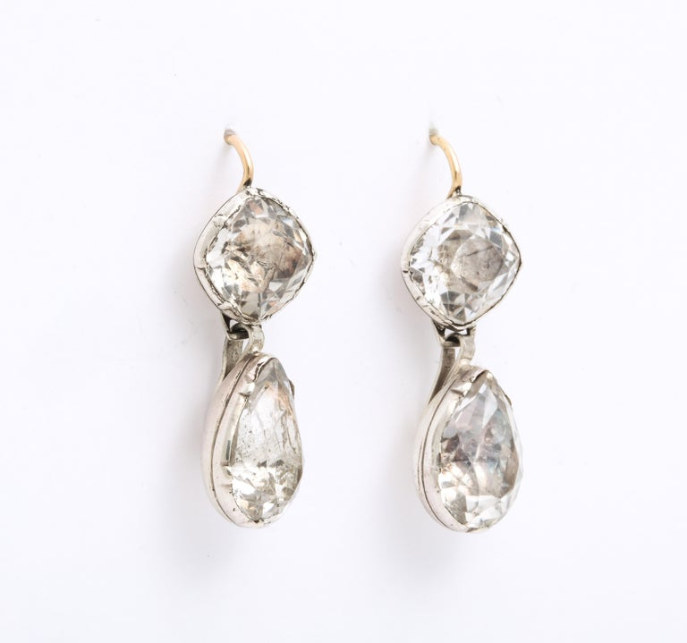 Magnificent, rare in size and glow, these Georgian foiled rock crystal earrings are set in their rounded closed foiled backs and shine brilliantly in sunlight or darkness. These earrings are a treasure of jewelry history and show what the royal love
