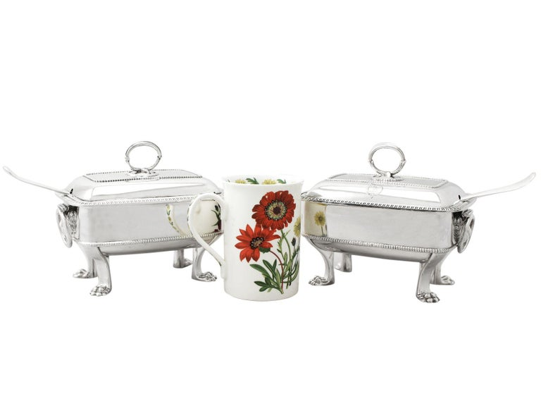 An exceptional, fine and impressive pair of antique George III English sterling silver sauce tureens with ladles; an addition to our Georgian silverware collection.  These exceptional antique George III sterling silver sauce tureens have a plain