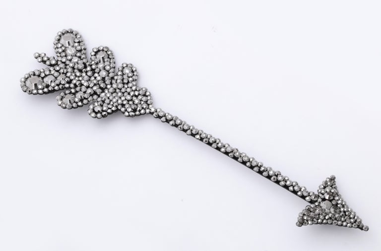 A film star, as well as a  statement of style, this dramatic Georgian Cut Steel Arrow Brooch is five inches in length and was shown being pinned on Meg in the movie the Age of Innocence, by Edith Wharton, as Meg's grandmother, the family matriarch