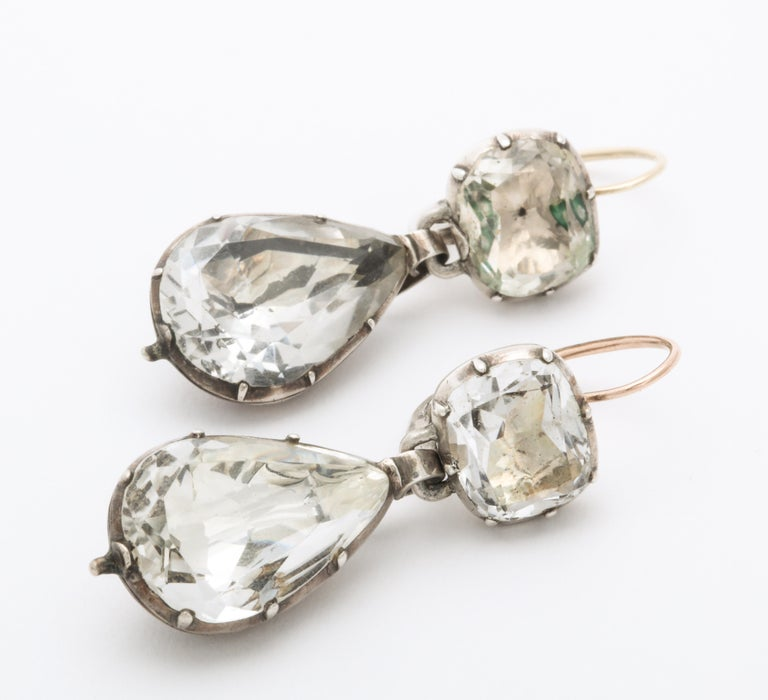 Magnificent, rare in size and glow, these Georgian foiled rock crystal earrings are set in their rounded closed foiled backs and shine brilliantly in sunlight or darkness. These earrings are a treasure of jewelry history and art and show what the