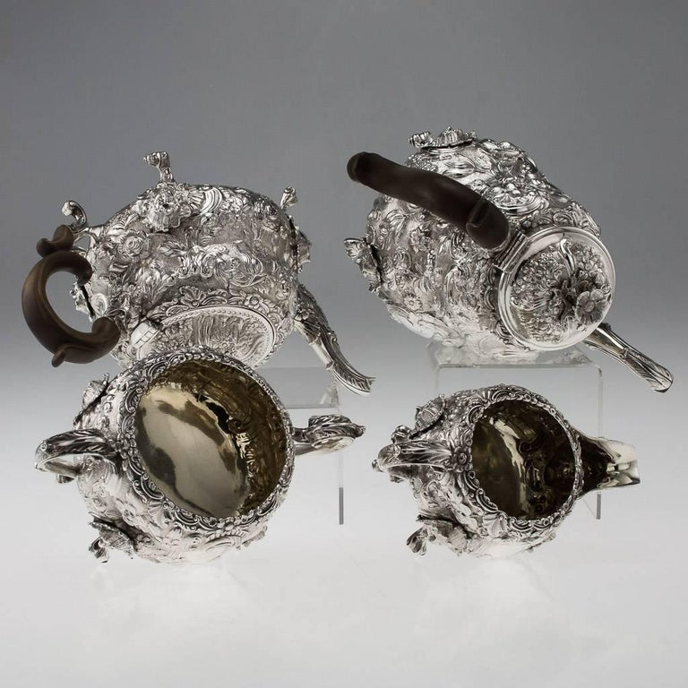 Antique 19th century magnificent George III solid silver tea and coffee set, comprising a coffee pot, teapot, sugar bowl and cream jug, each piece exceptionally heavy, crisp and decorative, chased with flowers and Rococo scrolls, cast mask and