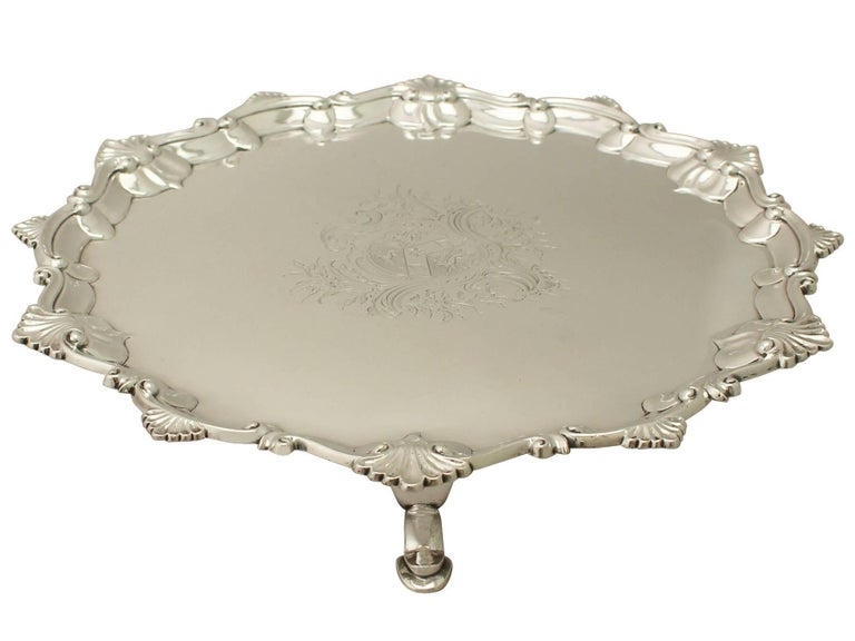 An exceptional, fine and impressive antique George III English sterling silver salver; an addition to our Georgian dining silverware collection.  This exceptional antique George III salver in sterling silver has a plain circular shaped, classic