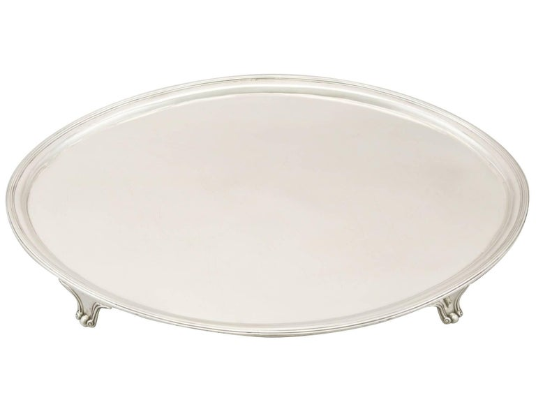 A fine and impressive, large antique George III English sterling silver salver; an addition to our Georgian silverware collection
