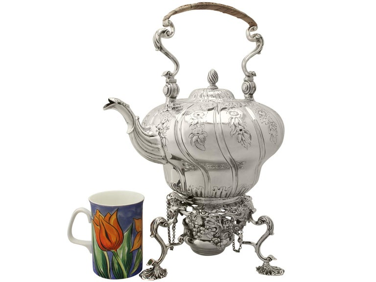 An exceptional, fine and impressive, antique Georgian English sterling silver spirit kettle made by William Grundy; an addition to our antique silver teaware collection.