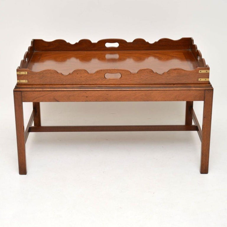 Antique George III style mahogany tray top coffee table dating from the 1930's period. It's high quality, in excellent condition & has just been French polished. The tray top can be just lifted off & used for carrying items. It has inset handles &