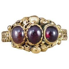 Antique Georgian Three-Stone Cabochon Garnet Ring in High Carat Gold
