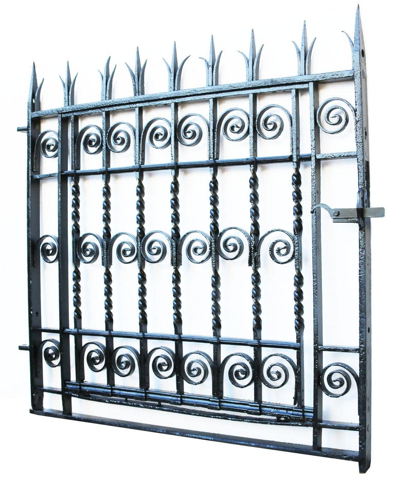 About  This impressive pedestrian gate has been shot blasted, primed and finished in black gloss.   Fitted with a working latch and hinges.  A rare cast and wrought iron 18th century side gate circa 1787.  Removed from a Wesleyan chapel in