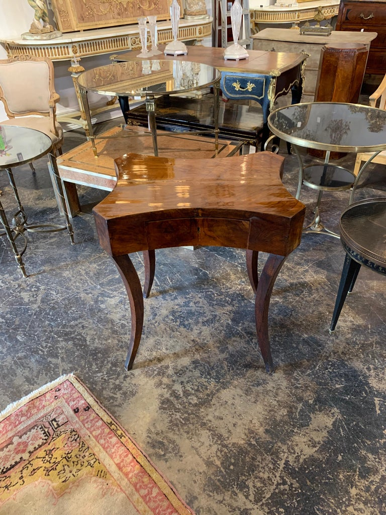 Beautiful antique German Biedermeier walnut side table with one drawer. A very sophisticated table with an amazing polished finish!