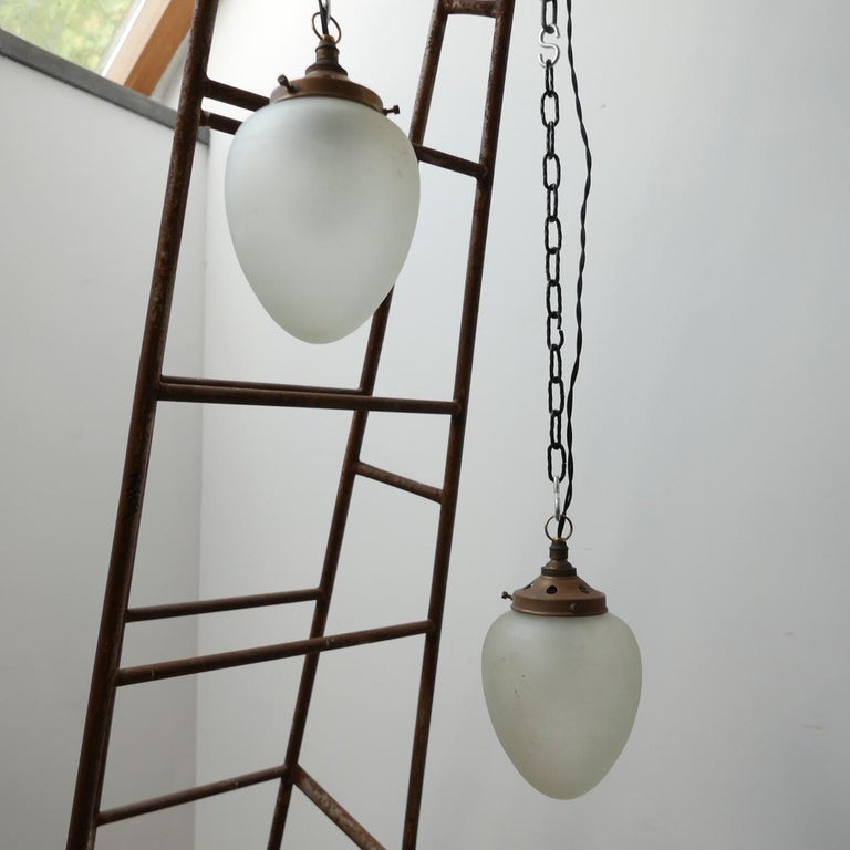 Early 20th century etched glass pendants with brass naturally patinated galleries.   Tear drop shaped.   German, c1930s.   Small, simple and elegant lighting solution.   Re-wired and PAT tested.   Two available.   Priced and sold