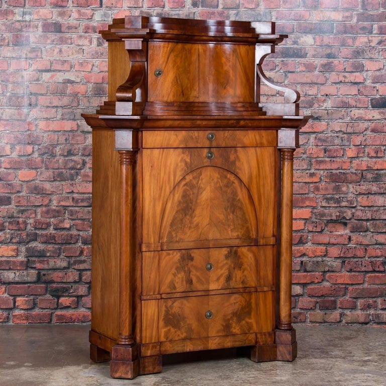 Outstanding early 19th century German Biedermeier secretary desk, circa 1830, with exceptional book matched mahogany drawer and desk front. The wood grain appears to glow from within with a shellac finish that brings the wood to life. The interior