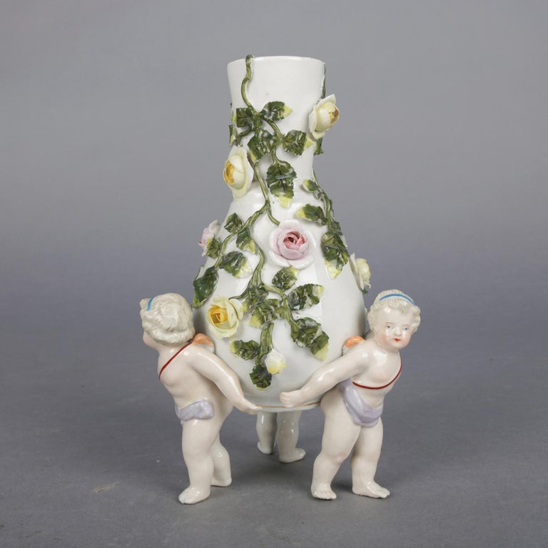Victorian Antique German Meissen Porcelain Figural Cherub and Rose Bud Vase, circa 1890 For Sale