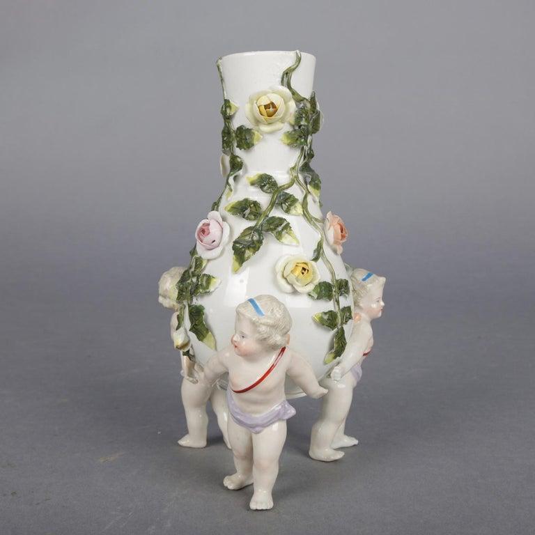Hand-Painted Antique German Meissen Porcelain Figural Cherub and Rose Bud Vase, circa 1890 For Sale