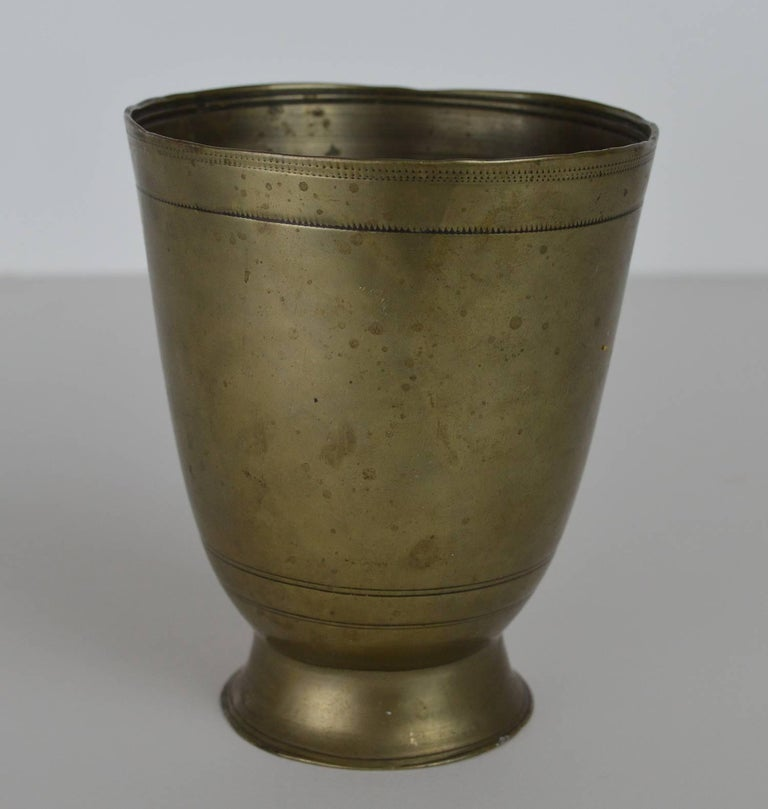 This fine antique tumbler cup has a plain circular form.
