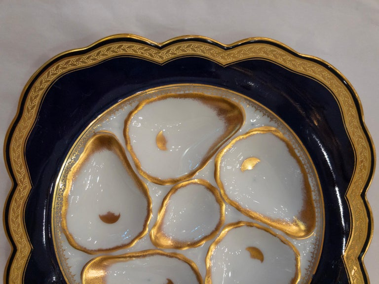 Antique German porcelain oyster plate in rare cobalt color with white oyster wells and gold trim, circa 1890s.