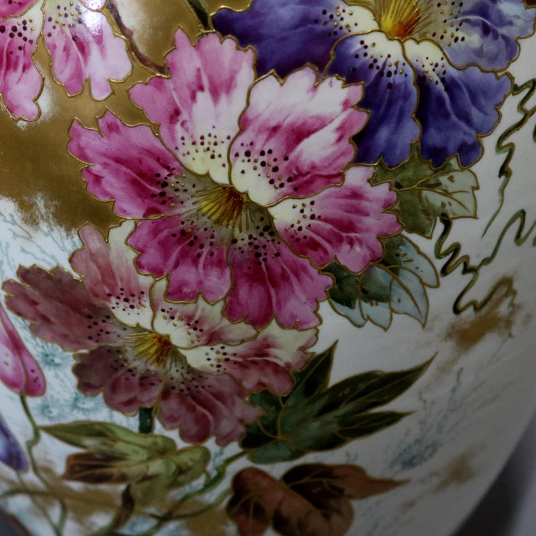 An antique German Royal Bonn hand painted lidded porcelain floor urn features all-over garden flower decoration with gilt highlights throughout. Hand numbered on base as photographed, 19th century.   Measures: urn: 17
