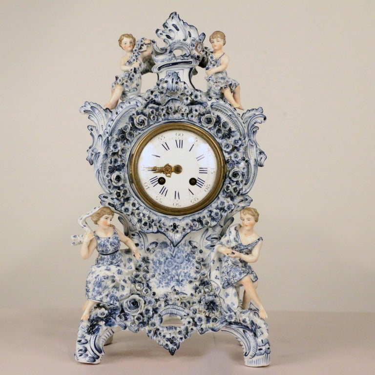 For those who enjoy the fine quality of blue and white German porcelain from the middle of the last century, this is a particularly fine example. On a white porcelain ground, hand-painted and applied with leaves and flowers, the clockcase and
