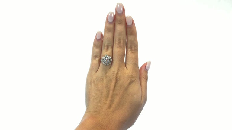 Antique GIA 1.53 Carat Old Mine Cut Diamond White Gold Cluster Ring. Featuring GIA certified 1.53 carat, H color, SI2 clarity (#6217960998). Surrounded by 8 Old Mine Cuts, approximately 2.00 carats total, H-I color, VS-SI clarity. Also four single
