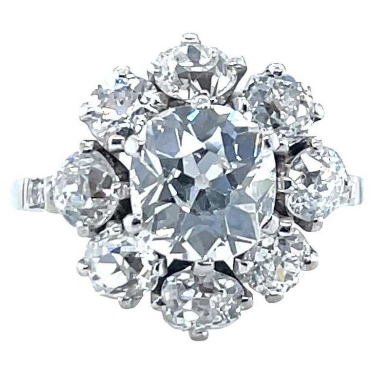 Antique GIA 1.53 Carat Old Mine Cut Diamond White Gold Cluster Ring For Sale