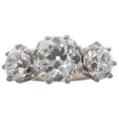 Antique GIA Three-Stone Diamond 18 Karat Gold Platinum Ring