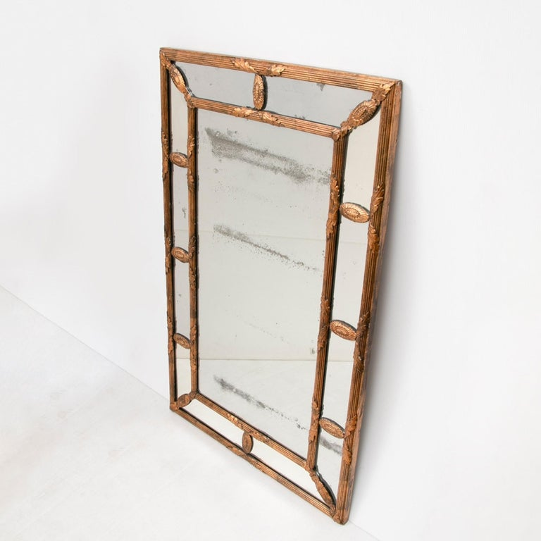 An early cushion mirror or margin mirror of excellent quality. It is in complete original condition and has a wonderful thin mercury mirror plate with overall foxing and original gilding. The back is also completely original pine, handcut
