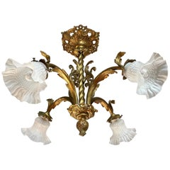 Antique Gilt Bronze and Brass Rococo Style Chandelier with Flowery Glass Shades