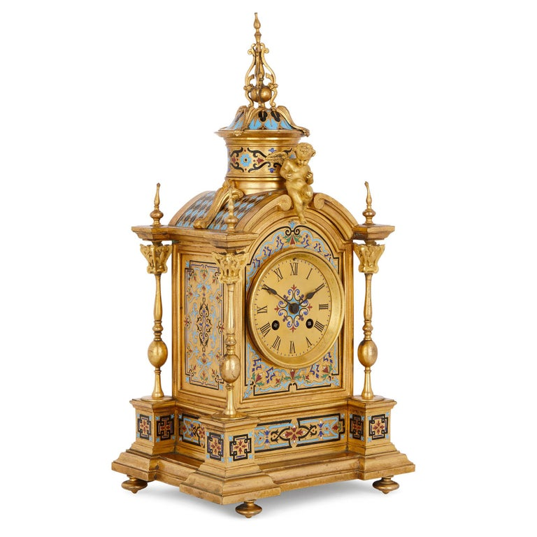 This beautiful clock set, which comprises of a mantel clock and a pair of vases, was designed in France in circa 1870 in a wonderful Renaissance Revival style. The set has been crafted from gilt bronze (ormolu) and ornately decorated with champlevé