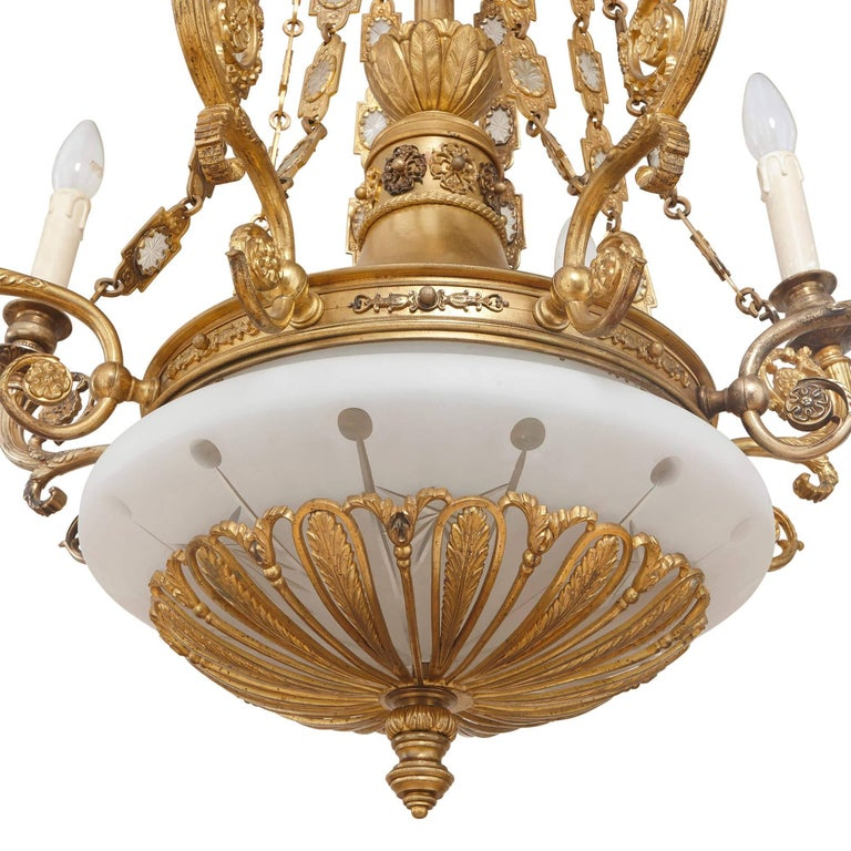 This beautiful, tall chandelier is ideal for a grand entrance hall or room where it can be seen and admired. It is an exceptional piece of Empire style design, perfectly combining glass and gilt bronze, with a sumptuous simplicity and