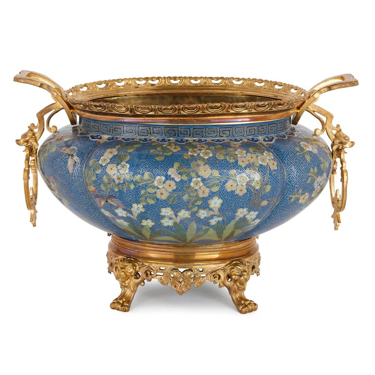 This exquisite cloisonné enamel jardinière was crafted in China in the 19th century, and then exported to France, where it was mounted in gilt bronze (ormolu). The piece speaks of the rich history of cultural exchange between the Far East and