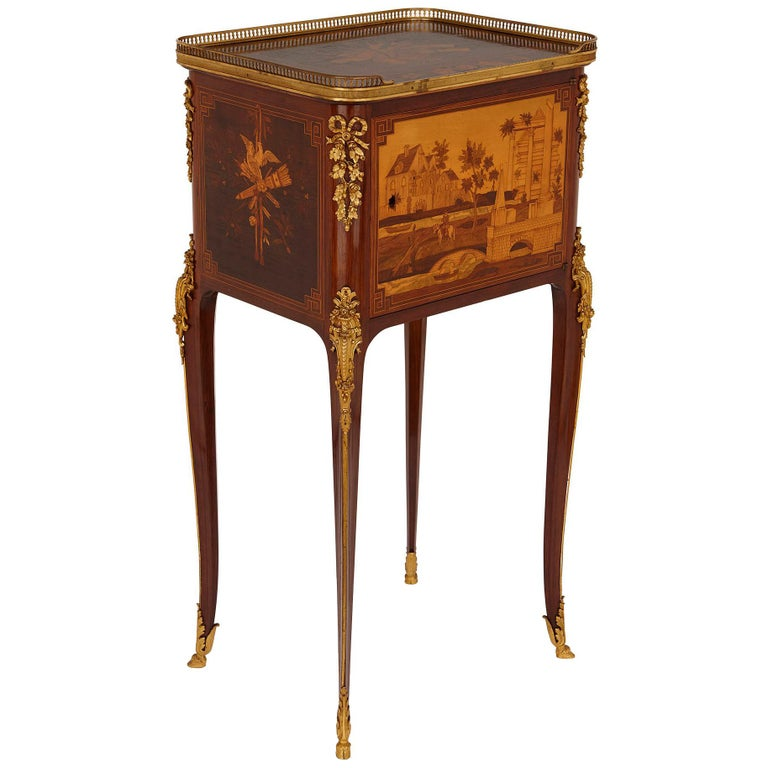 Antique gilt bronze mounted occasional table with marquetry panels For Sale