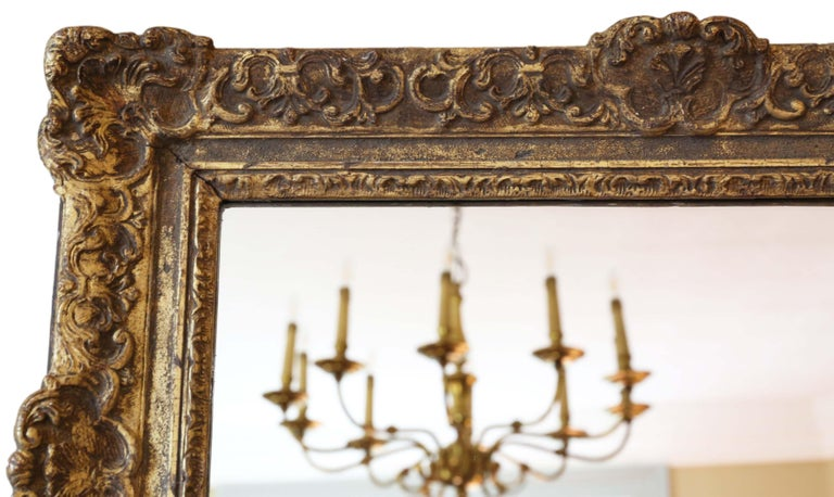 Antique large quality 19th century gilt overmantle or wall mirror. A great look. A charming mirror, that is full of age and character. Lovely frame with some losses touching up, refinishing and repairs over the years. Most of the original finish