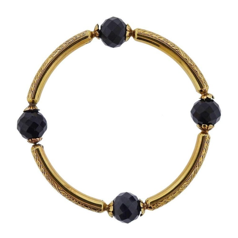 14k gold antique bangle bracelet. Measures 71mm inner diameter x 5.7mm wide. Weights 32.6 grams. Agate has a small chip, one is mismatched in color. Marked with gold Hallmarks.