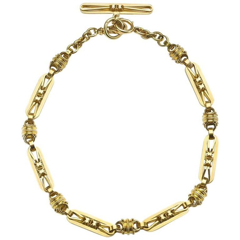 An antique gold Albert chain, with three dimensional long oval and barrel shaped links. This can be converted to a necklace, Circa 1870.