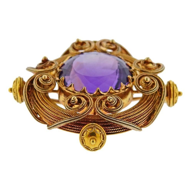 18k yellow gold antique brooch, set with approx. 21.5 x 18.2 x 13.5mm amethyst. Brooch measures 50mm x 47mm. Tested 18k. Weighs 30.2 grams.