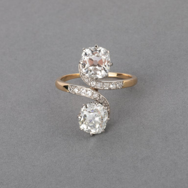 Very beautiful antique Ring, made in France circa 1900. Belle Epoque era. The two principal cushion cut diamonds weights 1.56 carats each. They are good quality, one H color estimate and the other J. Clarity is good SI1 estimate. Golf 18k for the