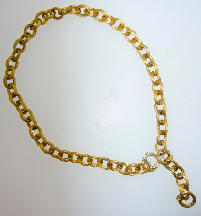 Antique  Victorian gold chain that can be worn several different ways.  The total length is 19 inches.  There is a two inch section that can be removed, or structured so that it can be a pendant chain.  This is a hand made link chain, probably