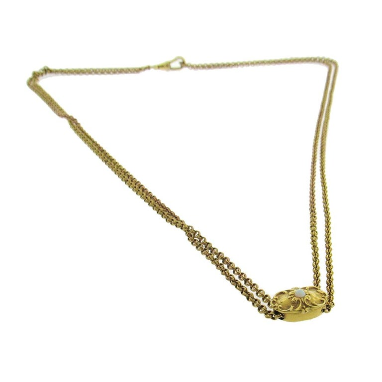 Antique long chain with slide in gold-fill, 56″ long, with clasp at one end is composed of double wire rolo links and can be worn as a necklace or used as a pocket watch chain. The 14K gold Art Nouveau slide is set with an opal