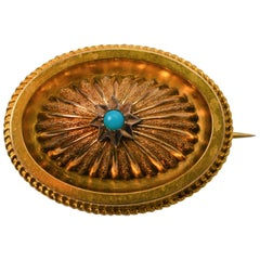 Antique Gold Medallion Brooch with Turquoise Accent