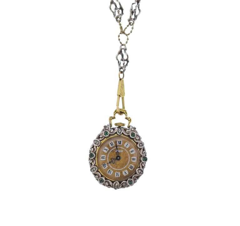 Antique silver and 14k gold chain with cage pendant, holding a pocket watch inside. Decorated with rose cut diamonds, enamel and  green gemstones. Pendant is 29mm in diameter. Chain is 28