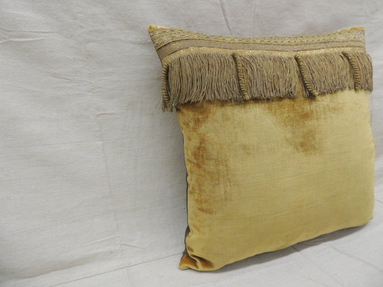 Antique gold velvet decorative square pillow embellished with 19th century metallic trims and gold metallic threads fring. Golden silk backing. Decorative pillow handcrafted and designed in the USA. Closure by stitch (no zipper closure) with
