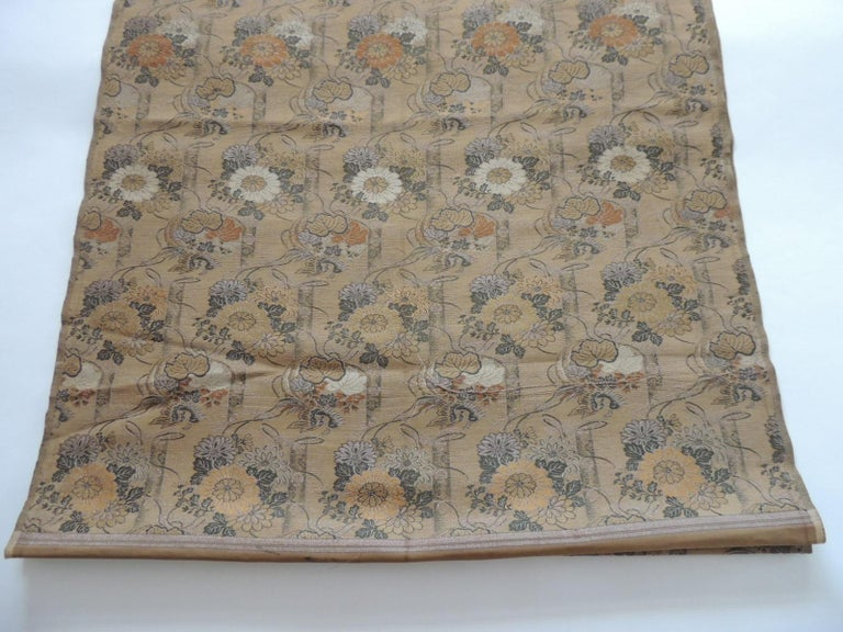 Antique golden and green woven silk obi textile. Woven textile with silk and metallic threads, depicting chrysanthemum and birds. Ideal for pillows, upholstery or shades. Size: 26