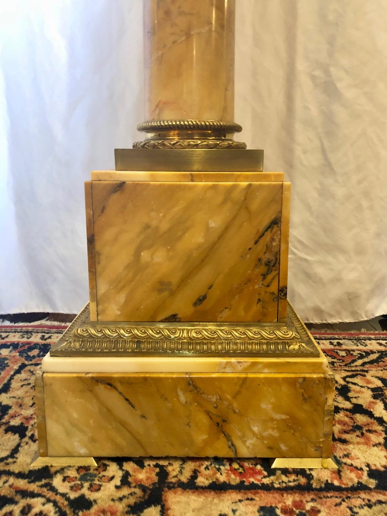 Antique golden marble revolving pedestal with ormolu mounts, circa 1820-1830.