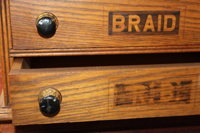 Antique Golden Oak Dexter Braid 2-Drawer Spool Cabinet For Sale 1