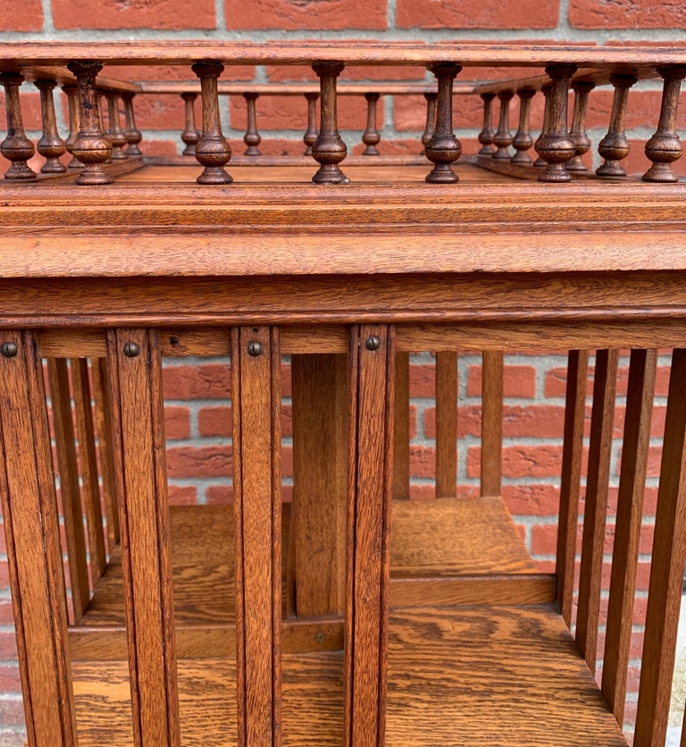 Arts and Crafts Antique & Good Size Early 1900s Tiger Oak Revolving Bookcase on Original Wheels For Sale