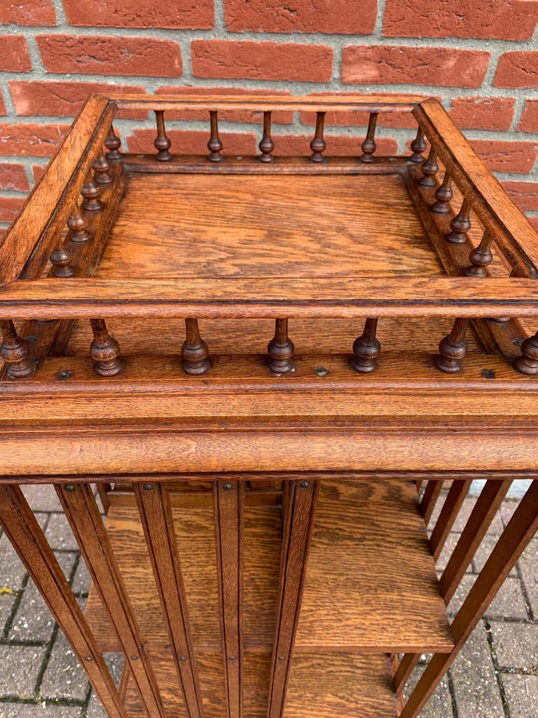 Hand-Crafted Antique & Good Size Early 1900s Tiger Oak Revolving Bookcase on Original Wheels For Sale