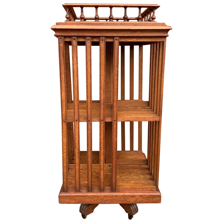 Antique & Good Size Early 1900s Tiger Oak Revolving Bookcase on Original Wheels For Sale