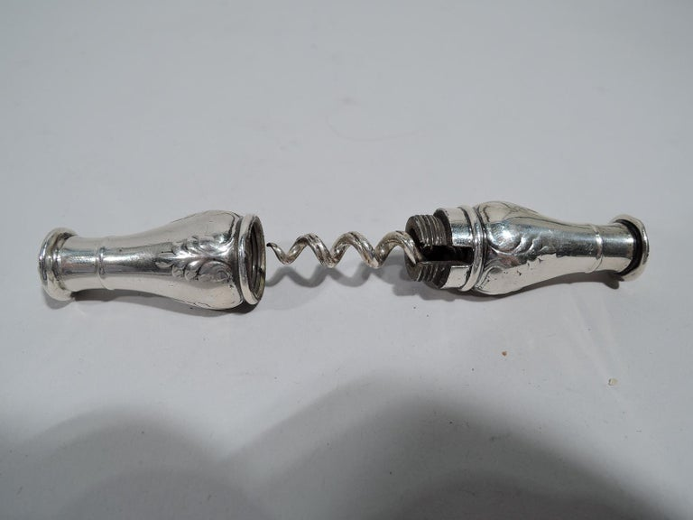 Edwardian Regency sterling silver corkscrew. Made by Gorham in Providence, ca 1910. Double baluster with raised pendant leaf ornament; raised paterae at ends. Cover threaded. Twist lock ensures a confident and successful tug. Handy purse size. Come