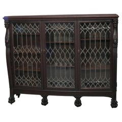 Antique Gothic Figural Oak 3-Door Leaded Glass Bookcase with Griffins circa 1890