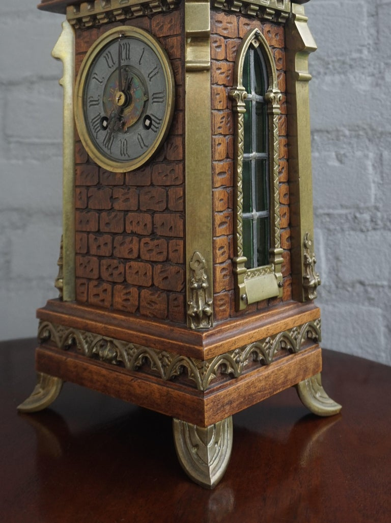 Unique cathedral design clock for the collectors of truly stylish Gothic antiques.  Finding this unique Gothic table clock truly felt like a blessing. The overall design is remarkable, but the combination of the craftsmanship of the carved nutwood