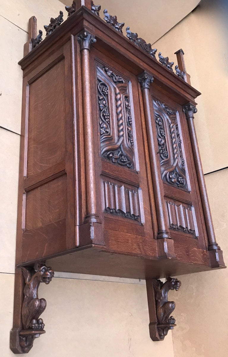 19th Century Antique Gothic Revival Hand Carved Oak Wall Cabinet with Gargoyles Sculptures For Sale