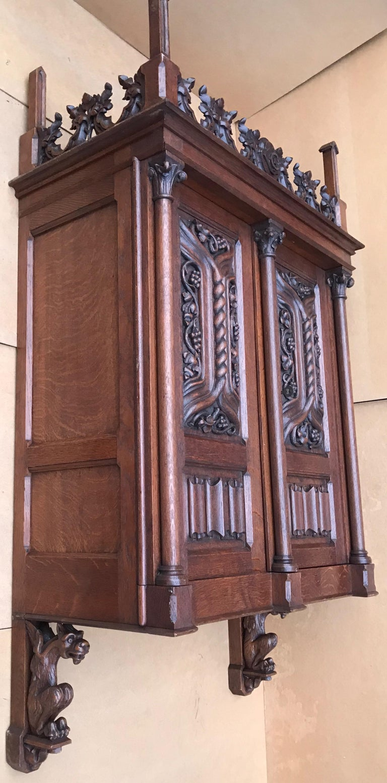 Antique Gothic Revival Hand Carved Oak Wall Cabinet with Gargoyles Sculptures For Sale 1